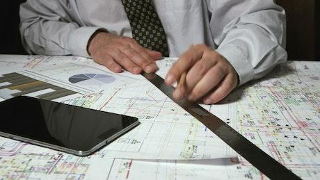Architect using a phone calculator