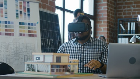 Architect using your total reality in the office