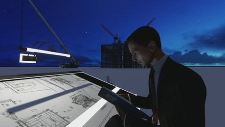 Architect working on a project in a rooftop