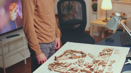 Architect working with a model at home