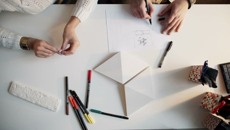 Architects planning at a desk with blueprints