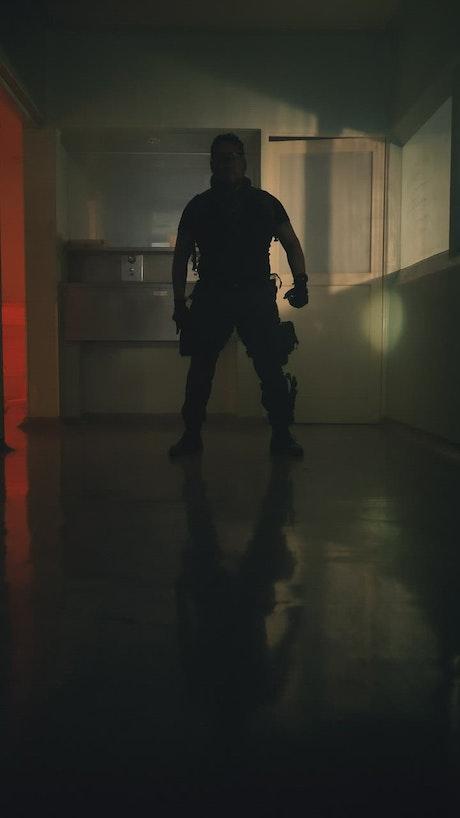 Armed survivor exploring an empty hospital