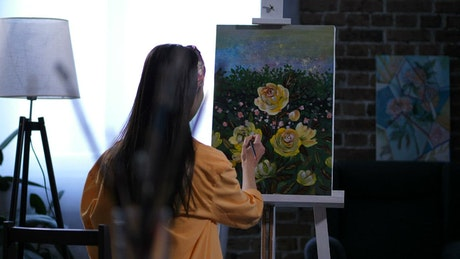 Artist adding the final details to her painting