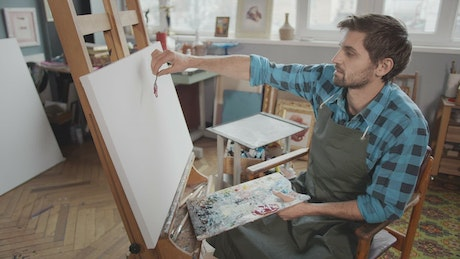 Artist looks for inspiration in blank canvas
