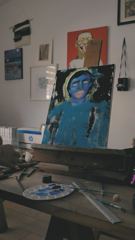 Artist painting an abstract portrait