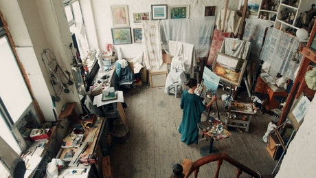 Artist woman painting in her studio