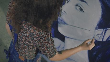 Artist working on a female portrait