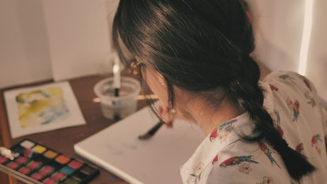 Artist working with watercolors