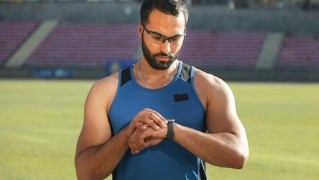 Athlete checks timer before run
