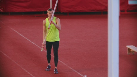 Athlete running and pole vaulting