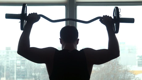 Athlete training with a barbell