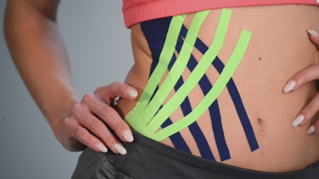 Athlete with kinesio tape on the hip