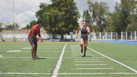 Athlete woman training with a coach