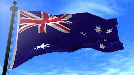 Australian flag waving in slow motion on blue sky