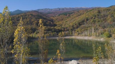 Autumn trees around a lake