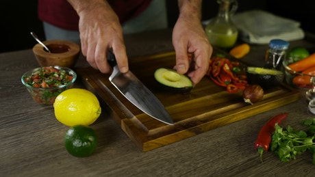 Avocado being prepared for a meal