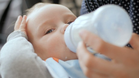 Baby drinking form the milk bottle