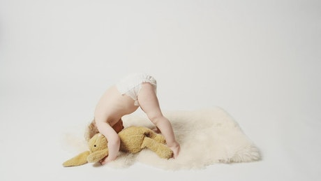 Baby girl playing in a photo studio