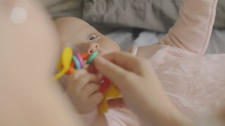 Baby holding a plastic toy