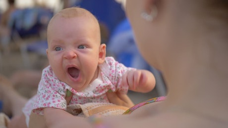 Baby yawning at the beach