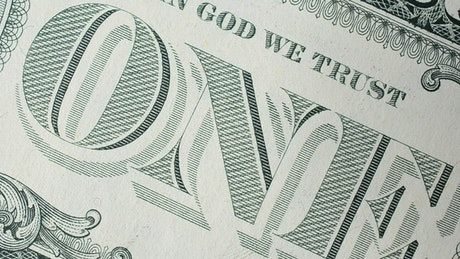 Back of a 100 dollar bill spinning