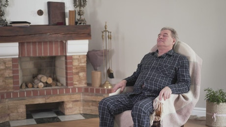 Back pain affects elderly man getting up from chair