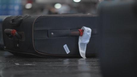Bags on an airport conveyor belt