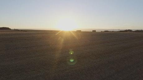 Bales of hay across a field