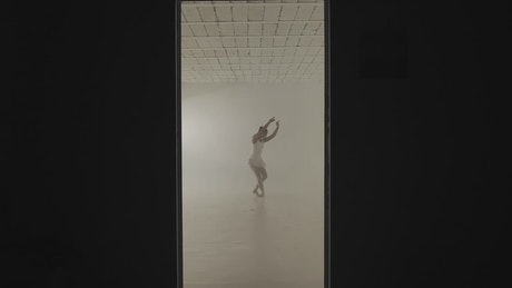 Ballerina dancing in a white room