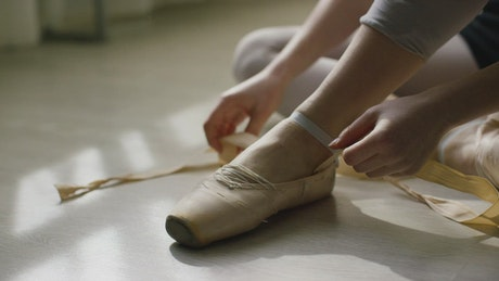 Ballerina preparing their shoes