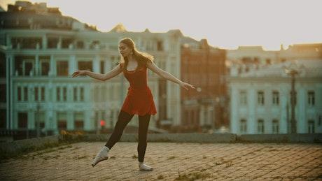 Ballet dancer dancing on top of a building
