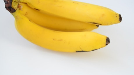 Banana on white background, spinning shot