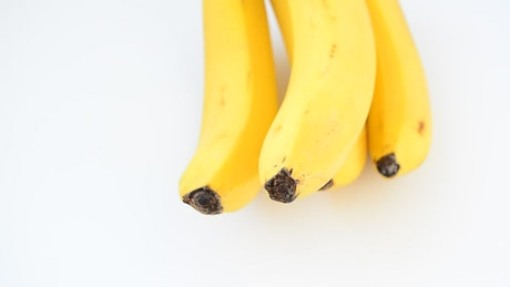 Bananas rotating on a white background