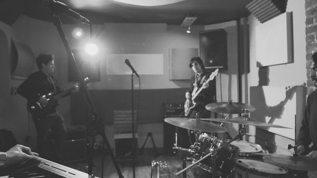 Band playing music in a recording studio