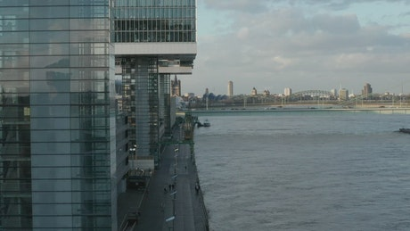 Bank of a river in a city with office buildings