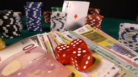 Banknotes, dice, cards and casino chips for betting