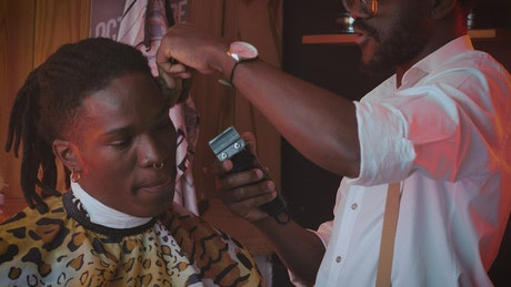 Barber cuts the hair of his client