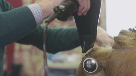 Barber drying long hair