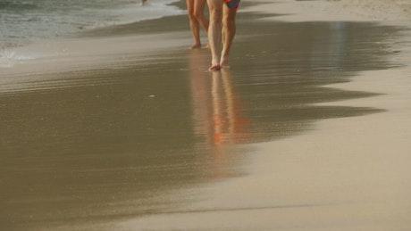 Barefoot man walking in the beach
