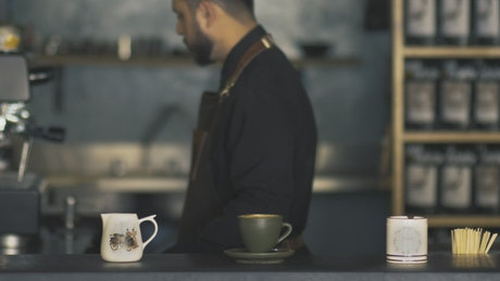 Barista cleaning a coffee machine
