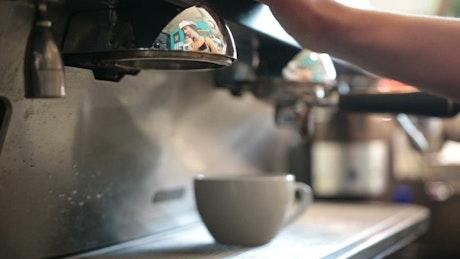 Barista making fresh coffee