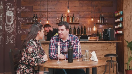 Barista surprises woman with gift during wine date in hip bar