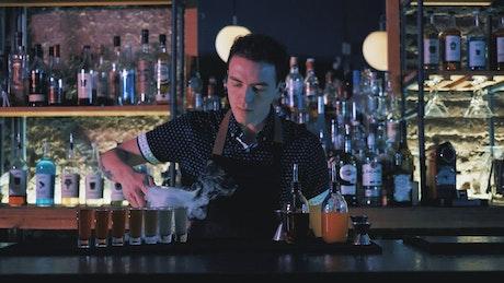 Bartender preparing shots