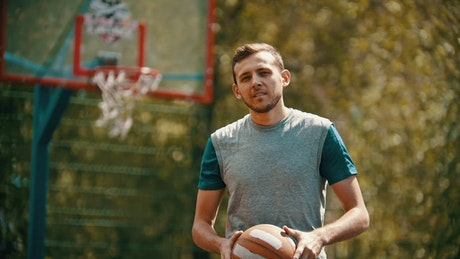 Basketball player turns and scores, portrait