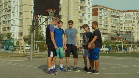 Basketball players stacking hands