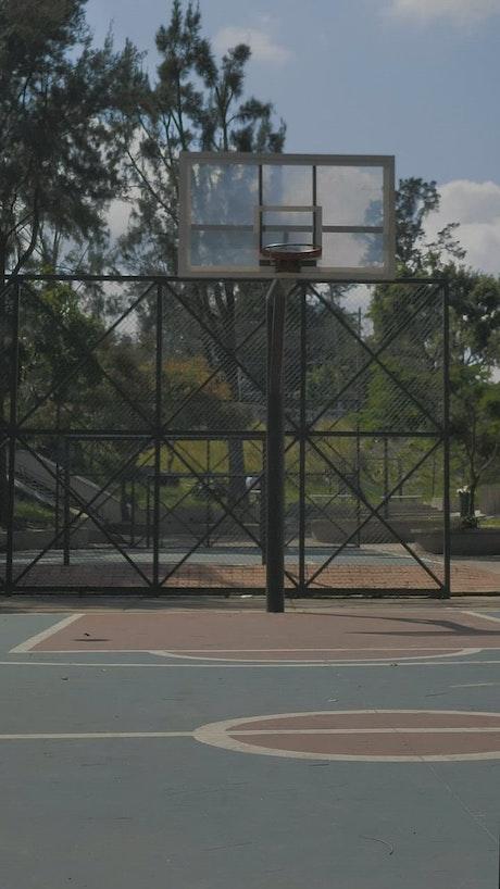 Basketballs being shot in a street rink