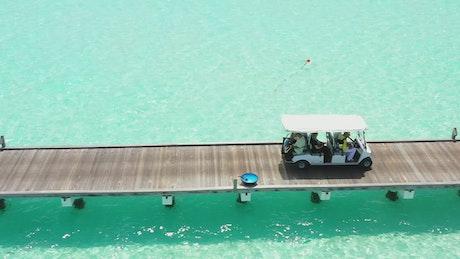 Beach golf cart on a wooden pier