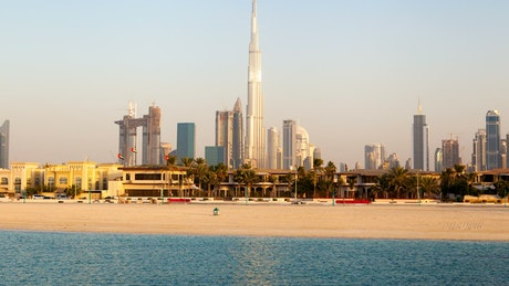 Beach in Dubai with cityscape in the background