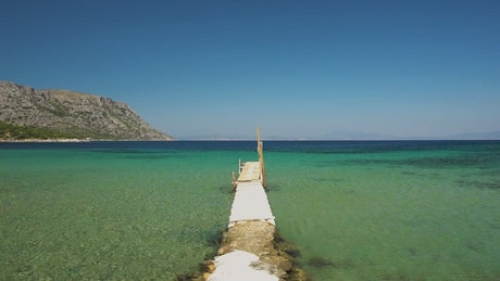 Beach pier on turquoise waters