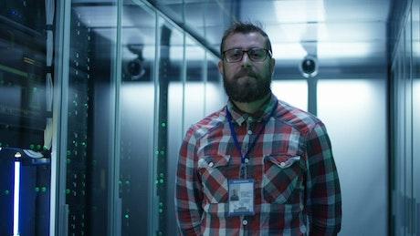 Bearded man in server room